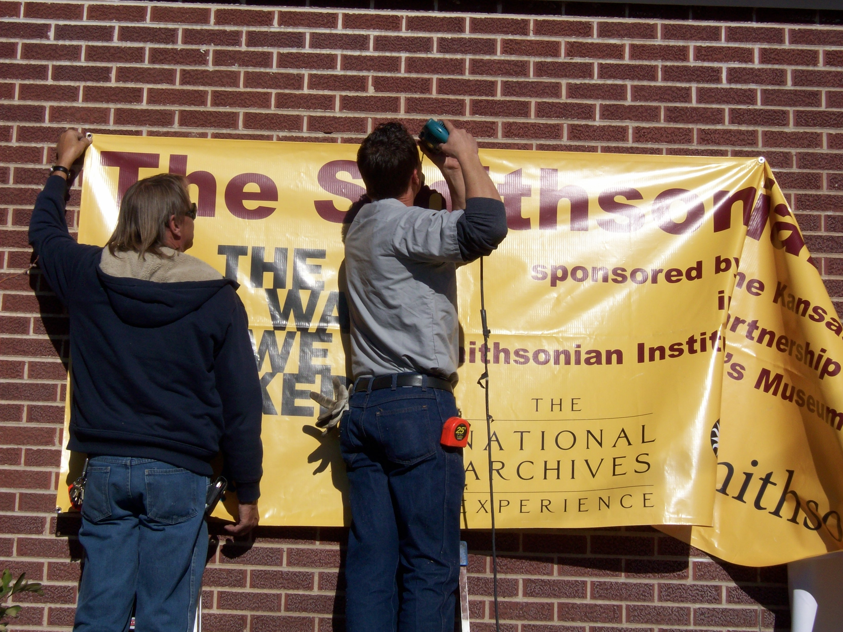 Ronnie and Ed attaching a banner to the outside of the museum to annouce the arrival of the Smithsonian!
