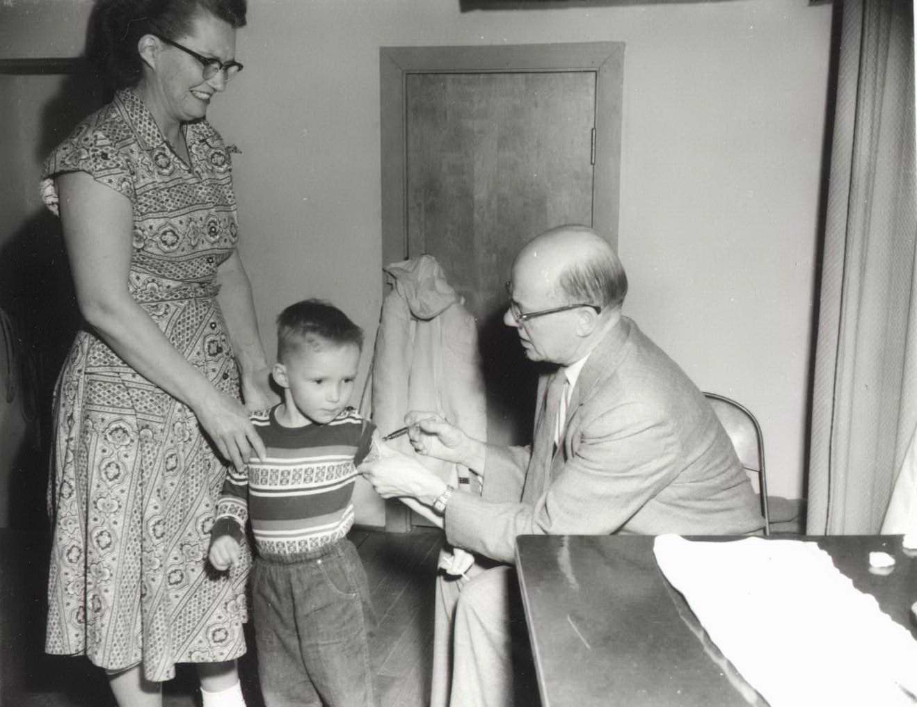 High Plains Museum | PM299MISC Dr. Vermillion administering a polio vaccine.