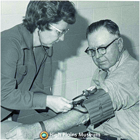 High Plains Museum | PM2390PEO Maxine Peter's checking blood pressure.